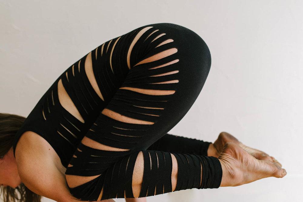 woman-yoga-pantsuit-in-yoga-pose-from-side-2©Copyright-Elisabeth-Waller.jpg