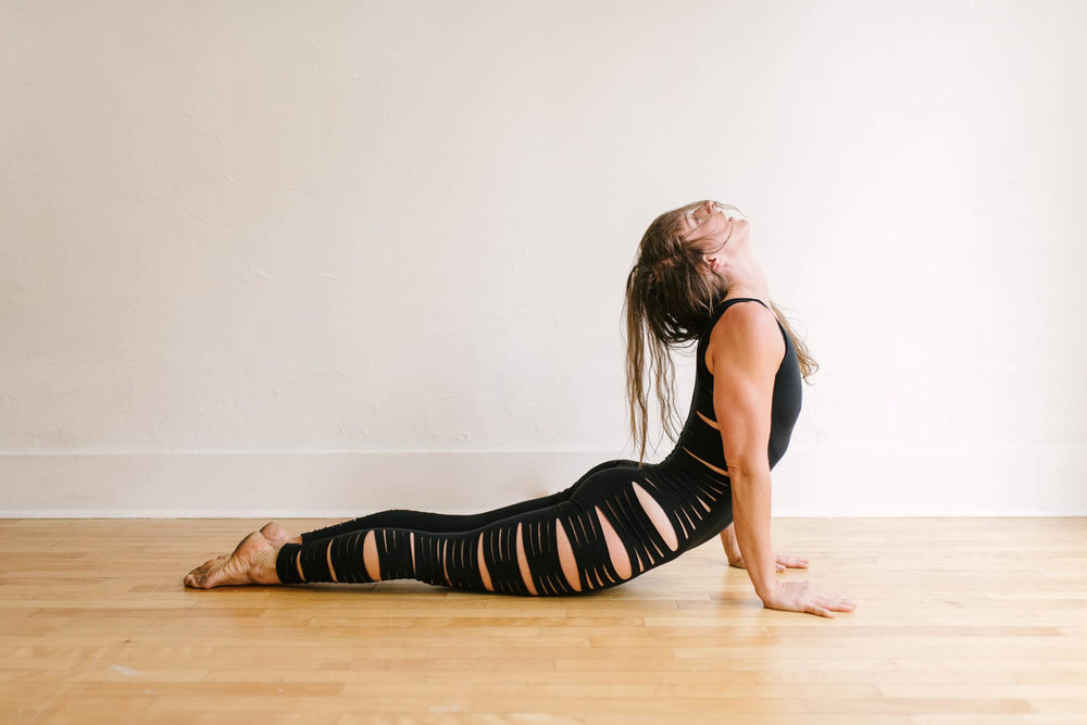 woman-yoga-pantsuit-on-floor-©Copyright-Elisabeth-Waller.jpg