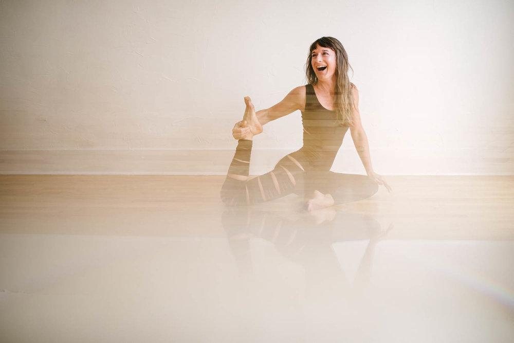 woman-yoga-pantsuit-pigeon-pose-laughing-©Copyright-Elisabeth-Waller.jpg