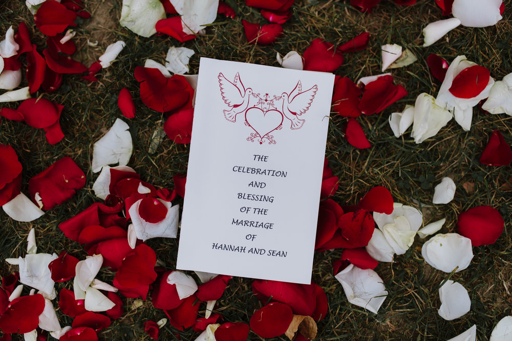 wedding-program-on-ground-rose-petals-13©_Elisabeth-Waller.jpg