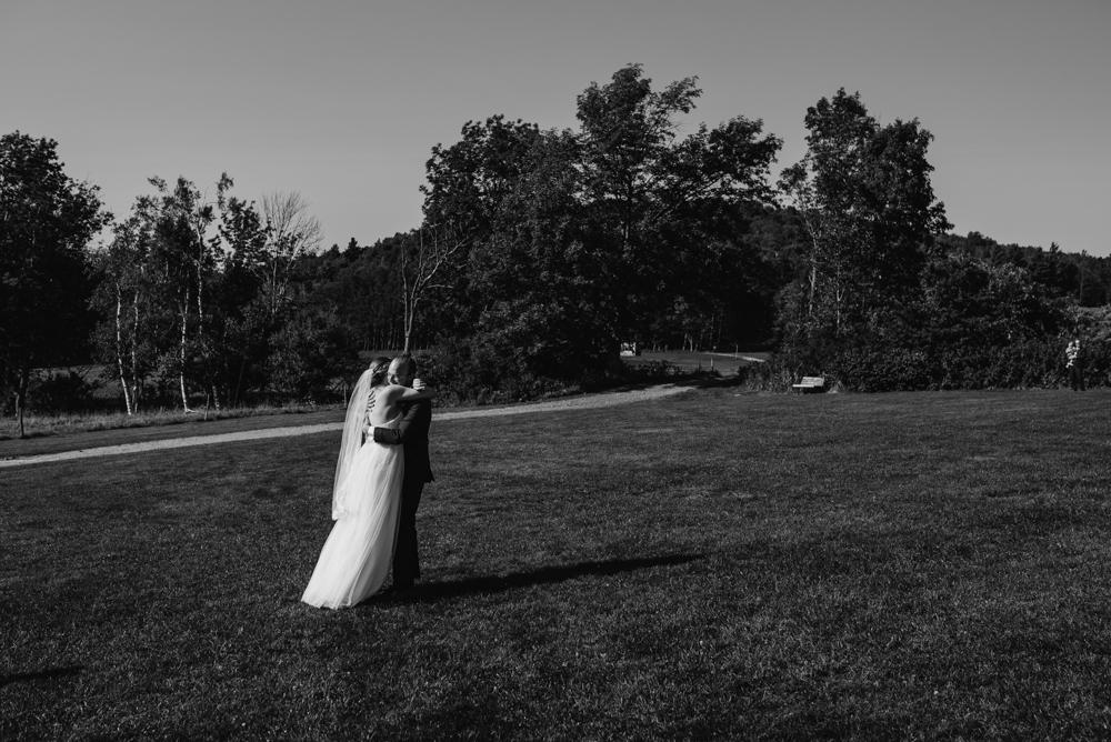 bride-groom-couple-hugging-photographer-vermont-stowe-destination-©Elisabeth-Waller.jpg