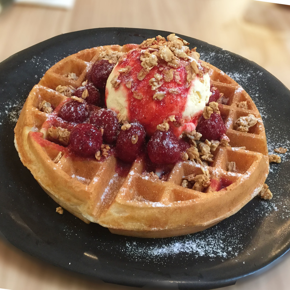 Buttermilk Waffles with Vanilla infused Strawberry Compote  Topped with Vanilla Ice Cream and Granola
