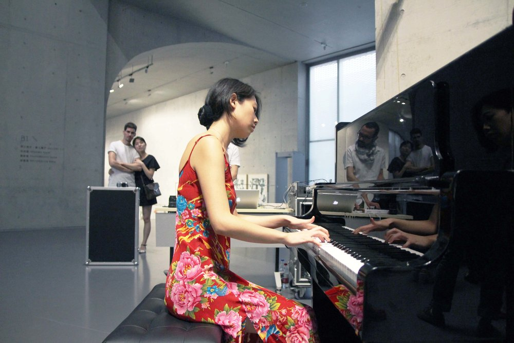 Hanan Bensho and Christine Zhou crafting a live score for the performance piece