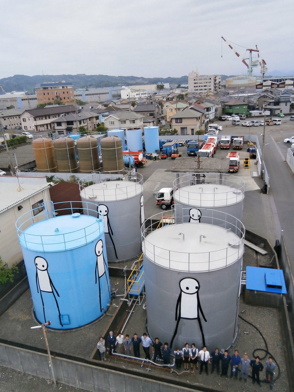 Oil Recycling Plant The four tanks clean impurities out of reclaimed oil so it can be re-used. The giant figures walk round and round endlessly echoing the recycling process. Shimizu, Japan, 2013.