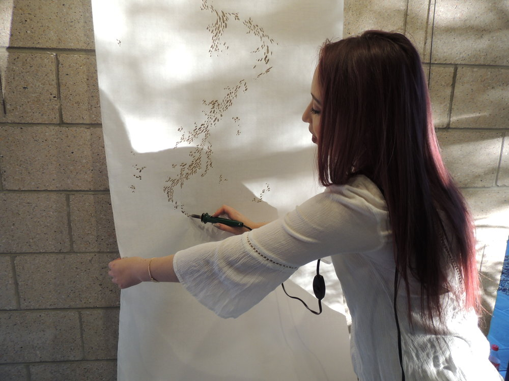 Gianna created a special wood-burning piece just for this event.