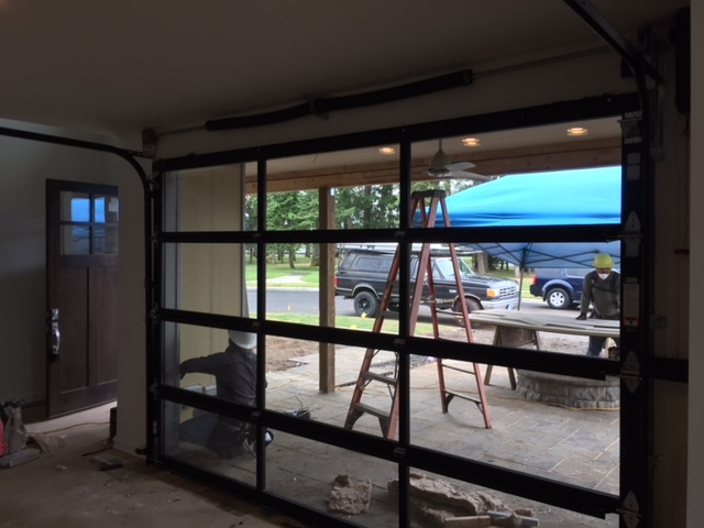 A glass garage door in the dining room!