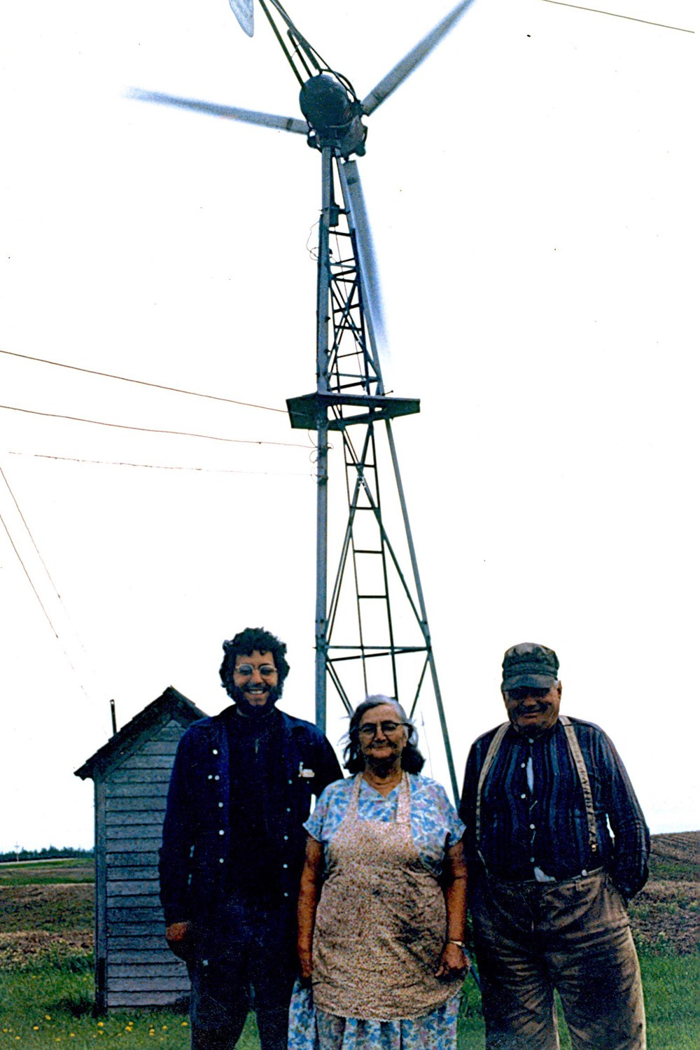 Archival photo of Don Mayer (center) pictured with Mr. & Mrs. Eldy Schragg, who were responsible for teaching him about the Jacob's Wind Generators. Photo courtesy of Don Mayer.