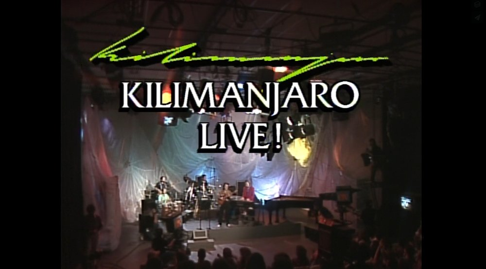 KILIMANJARO LIVE Recorded live in the Vermont PBS studio in 1990, this hour-long program documents one of the most well-known musical groups to come out of Vermont, featuring guitarist Paul Asbell, who performed and recorded with John Lee Hooker, Otis Rush, Howlin' Wolf and Muddy Waters and bassist Tony Markellis (who in recent years has done five U.S. tours with Phish guitarist Trey Anastasio) had been a member of the David Bromberg Band. Kilimanjaro joins forces with B.B. King alumnus Big Joe Burrell on stage as well in this classic televised performance. Click the image to view