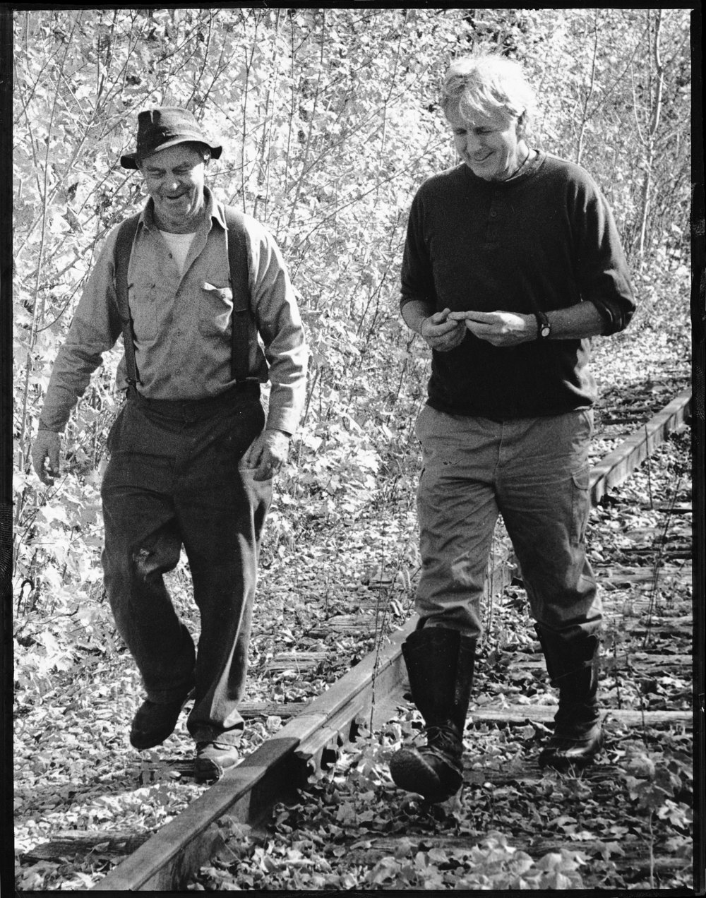 Copy of Ethan (right) walking with Frank Foster along the St. Johnsbury and Lamoille County railroad train trestle. Photo by Melissa Fisher, 1998