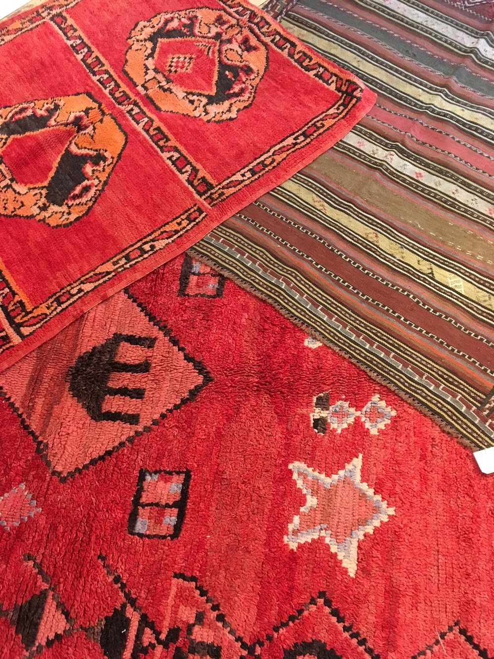 Classic Moroccan Boujaad and Zemmour rugs.  Also, the one rug we have that is not Moroccan. An Iranian kilim in the dusty palette that Pantone dreams are made of.