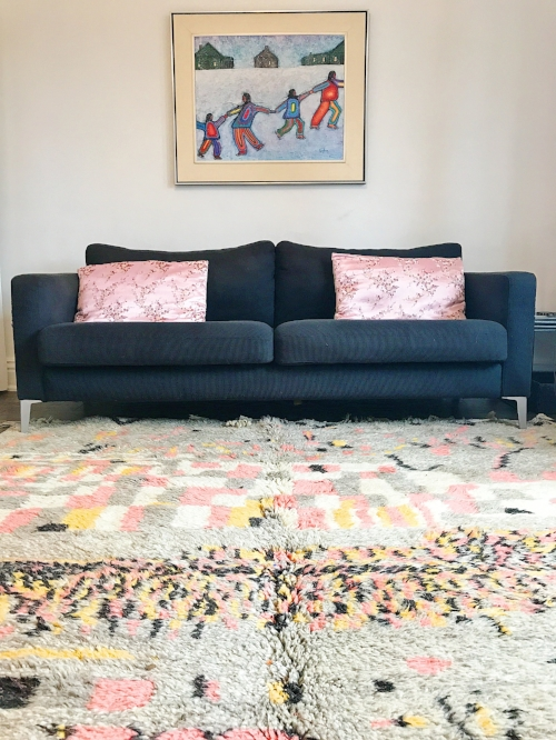 8'x10' beauty with hits of millennial pink making an Ikea couch look great