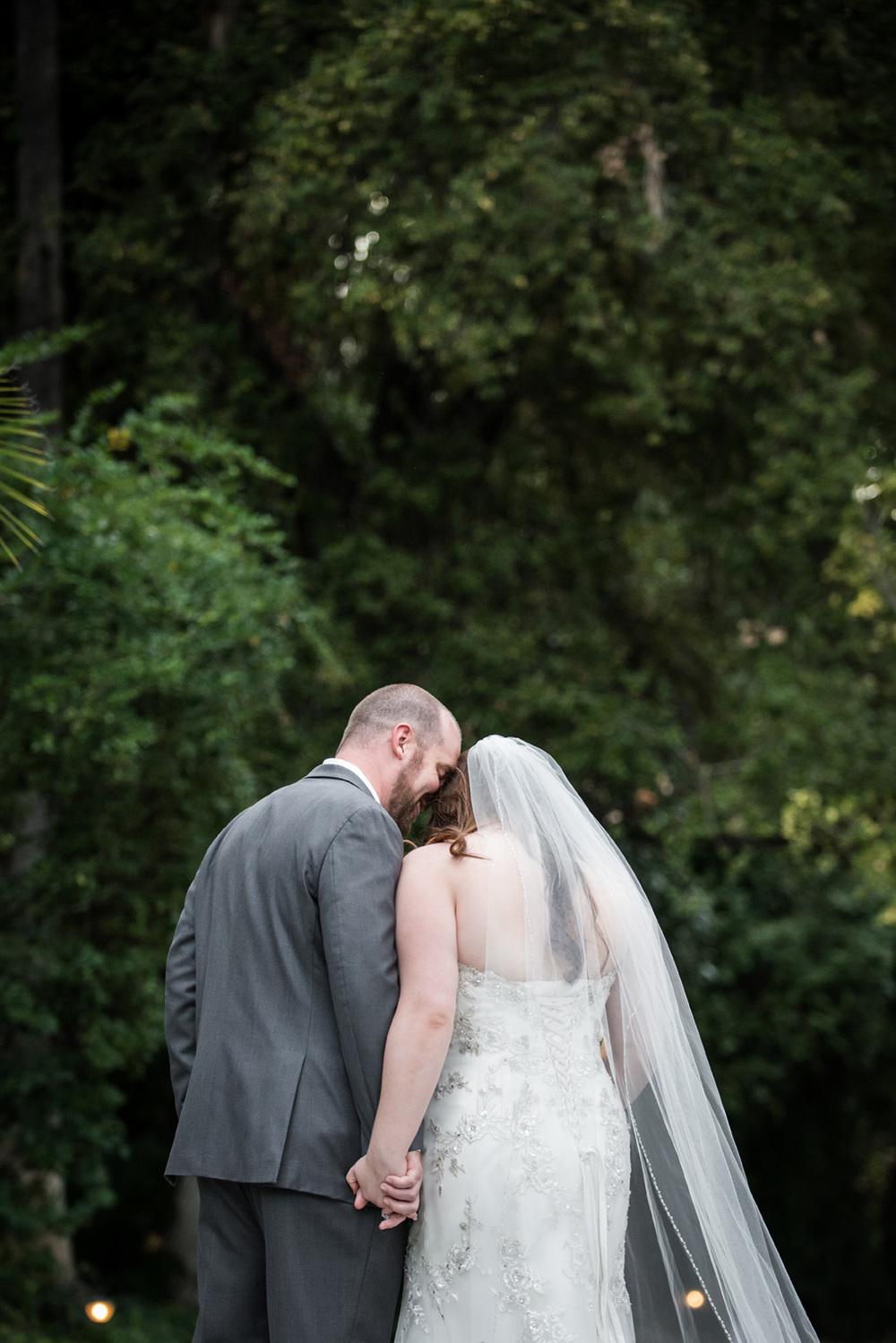 redlands_wedding_couple_holdinghands_realwedding