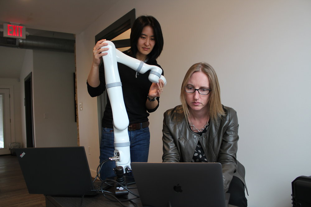 Diligent Robotics Co-Founders Vivian Chu (left) and Andrea Thomaz (right) working on the Moxi arm prototype at NCV's offices.