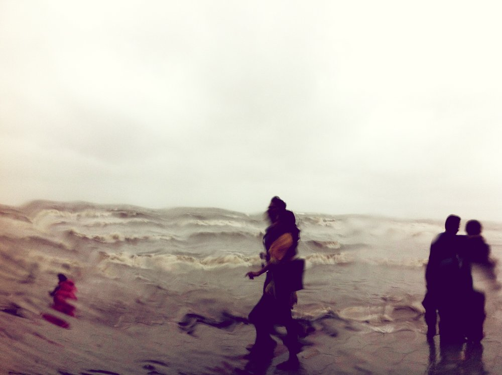 - Taking in the monsoon along Bandra's Bandstand promenade.