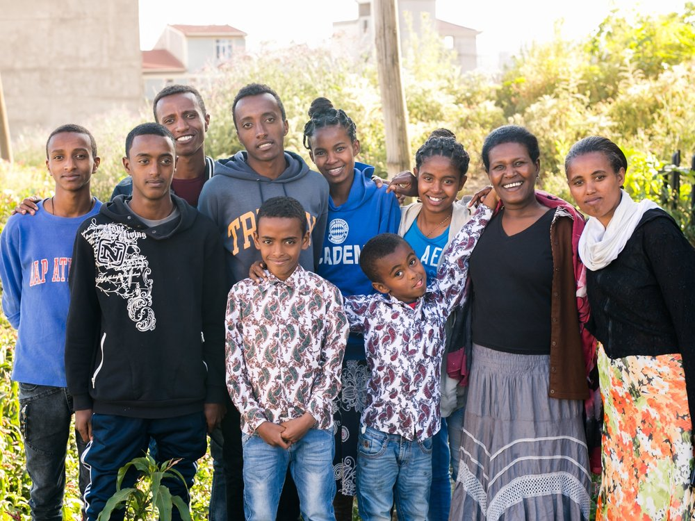 Abay House is one of Selamta's 10 Forever Families. Mama Alemnesh is raising 10 kids from the age of 6-24. This family needs a Family Sponsor.  Photo by Sarah Jane Langham