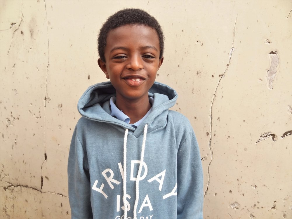 Nati lives in Tewodros/Bishangari house with 9 Selamta siblings. He is the youngest, but he sure keeps up with them! He's always gigling and loves a good dance party. Nati needs a Friend Sponsor.
