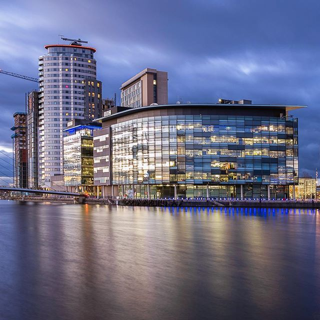 MediaCityUk - a crop of my latest shot of MediaCityUk. I wanted to add some learnings from my last trip here. I wasn't a fan of the full composition and I wanted to smooth water out before it got too dark. Full image is posted on my story.  #mediacityuk #manchester #canon #architecture  #photography #photo #photos #pic #pics #picture #pictures #art #beautiful #instagood #picoftheday #photooftheday #color #all_shots #exposure #composition #focus #capture #moment #city #cityscape #ig_color #ig_shotz