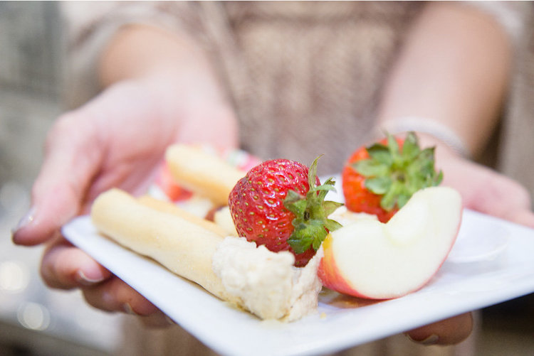Guest Shows Plate Of Strawberries A Applesand Breadsticks