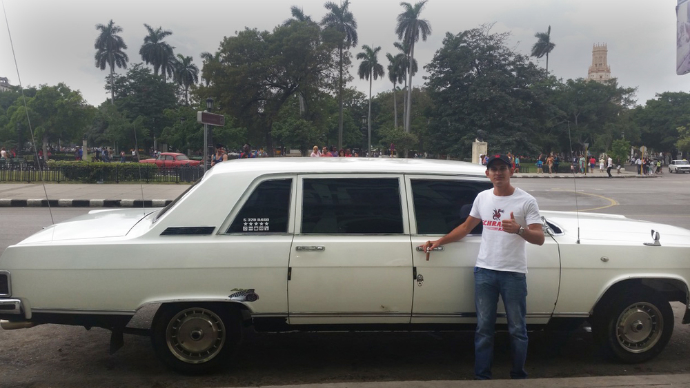 Photo: Leticia Leon Even the Cuban chauffeur, Alejandro Ferrer Laguna proudly driving Fidel Castro's old 1984 Russian zil limousine enjoys the Schrader Sparky Cigar.