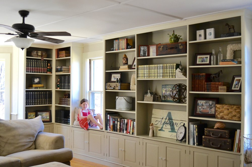 After: Built-in bookcases styled in this family room with favorite family items.
