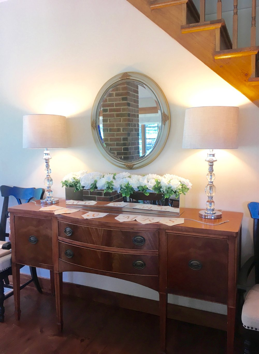 After: We swapped out a heavy (physically and visually) china cabinet with this sideboard in this clients kitchen. Not only is it pretty, but it's a usable surface for the family wedding they were hosting!