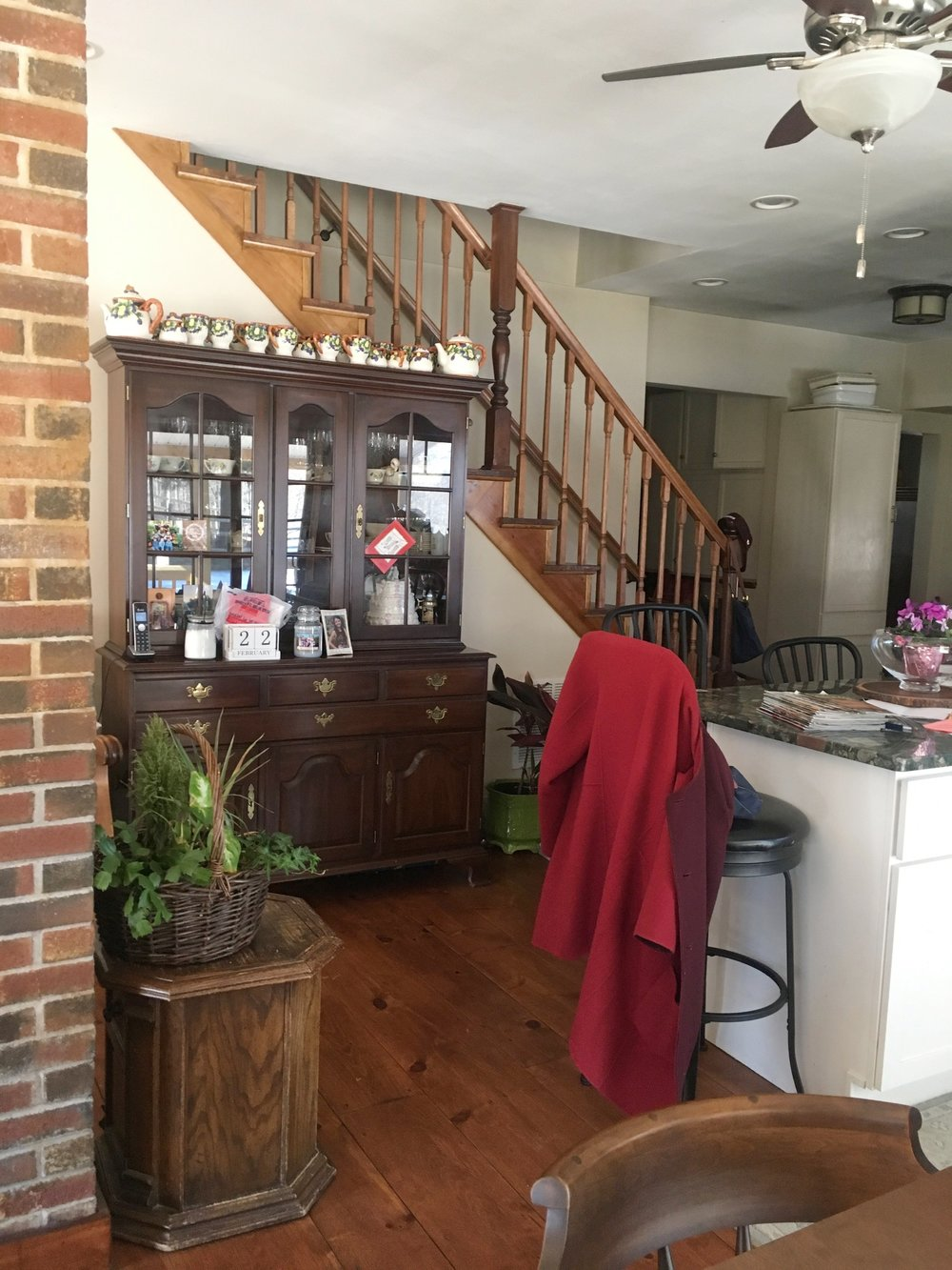 Before: This heavy china cabinet was taking up too much room physically and emotionally. It also became cluttered with objects that the homeowner no longer used.