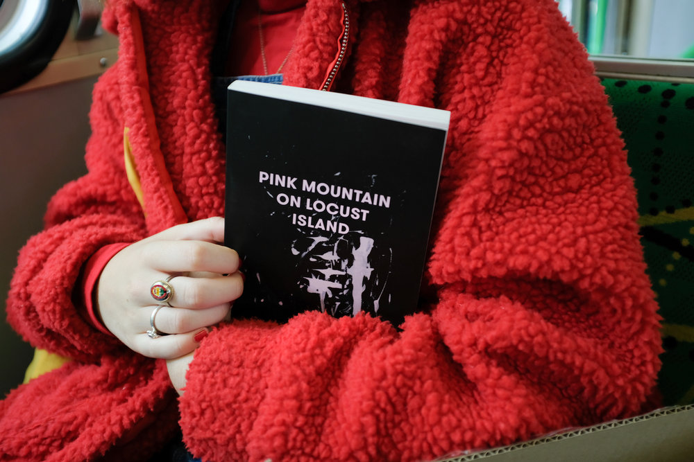 "Pink Mountain on Locust Island   Jamie Marina Lau  ""Lau's surreal prose captures the confusion of adolescence in the 21st century. Vivid, inventive descriptions of yum cha, high-school friendships and claustrophobic apartment living evoke the experience of growing up in a diasporic community and the sensory overload of being surrounded by people, yet still alone.""  – Books+Publishing"