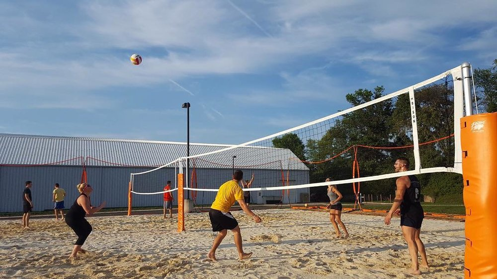 NLA Outdoor Sand Court Our outdoor sand courts replicates playing any sport at the beach. We offer a professional sand arena which will serve as a venue for leagues and tournaments for sports like volleyball, and spikeball. Our outdoor arena is netted for protection.