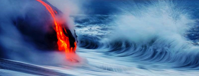 Lava flow into the ocean birthing new land