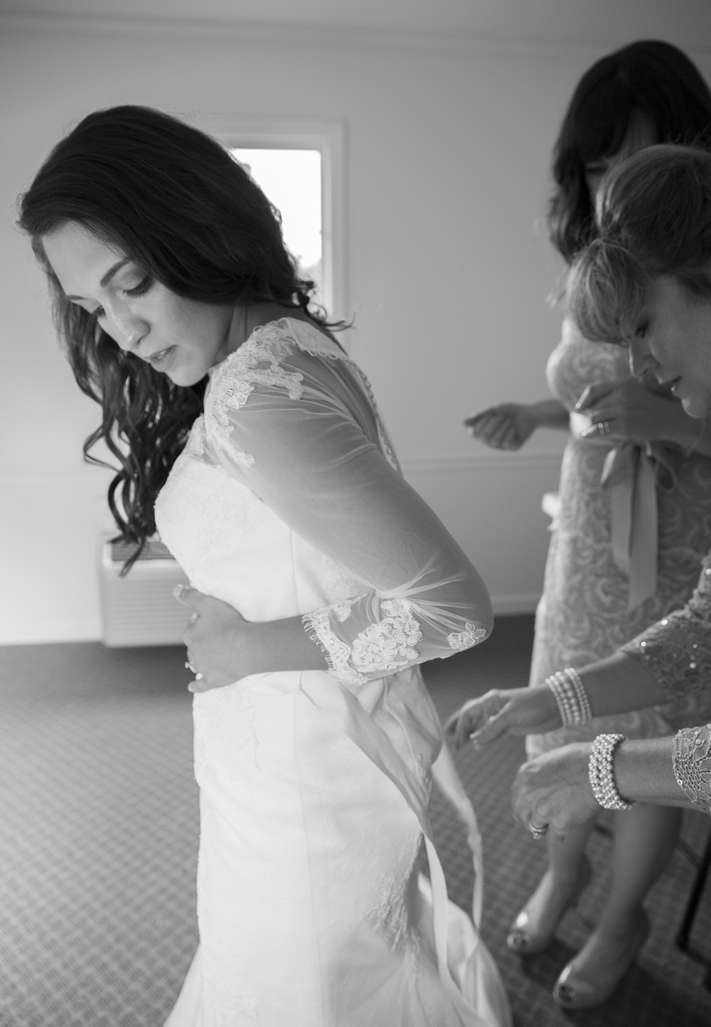 The woman in white finishing the final touches before the walk down the aisle. Pretty moving moment; both Alanna's adoptive mother + birth mother were there by her side the entire time.
