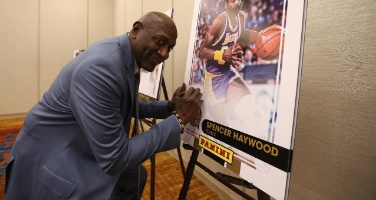 Spencer Haywood signs a print ahead of the Naismith Memorial Basketball Hall Of Fame 2014 Class Announcement KING 5