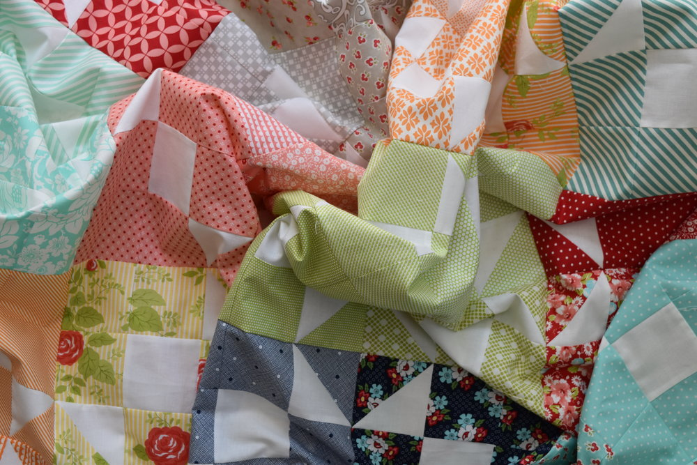 A colourful combination of Bonnie and Camille Fabrics created a quilt called Glow...