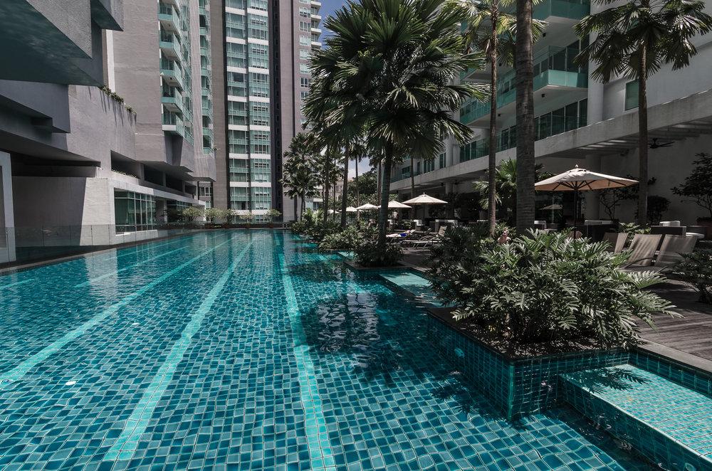 lanson-place-kuala-lumpur-malaysia-pool-palm-trees.jpg