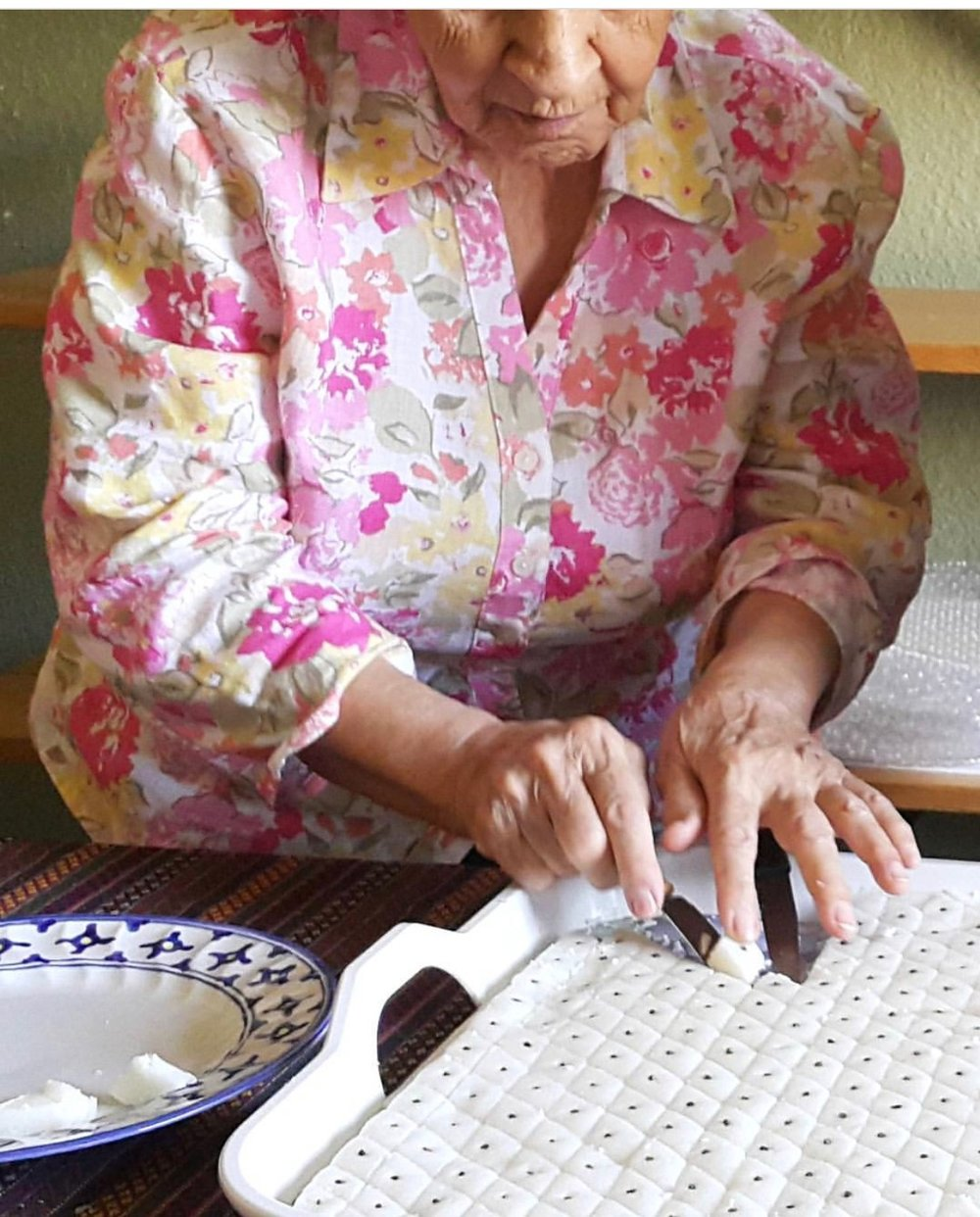 Mom making coconut diamonds for my nephew's wedding last September in Iran.