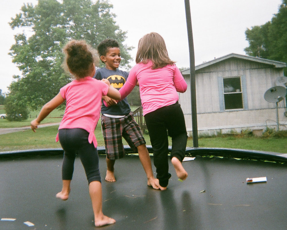"Trampoline Fun  by Cierra Driggers   ""She had just gotten hurt and started crying but then my niece and friend got her up and started jumping to make her feel better."""
