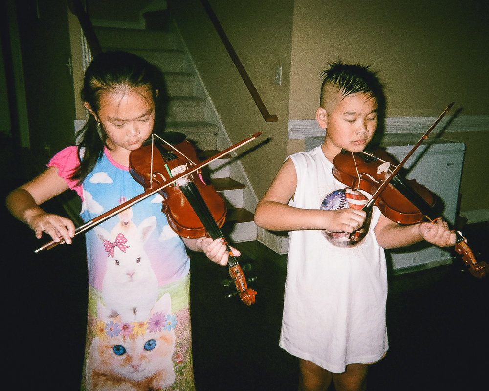 "Practicing Violin  by Vincent Chen   ""I like to play the violin. It's my first year. I'm glad to be here so I can play the violin."""