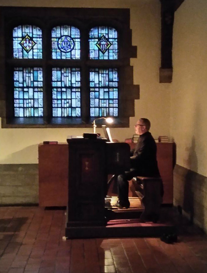 The Rector, Fr. Richard Alton, plays the organ during a Caroling event Winter 2016