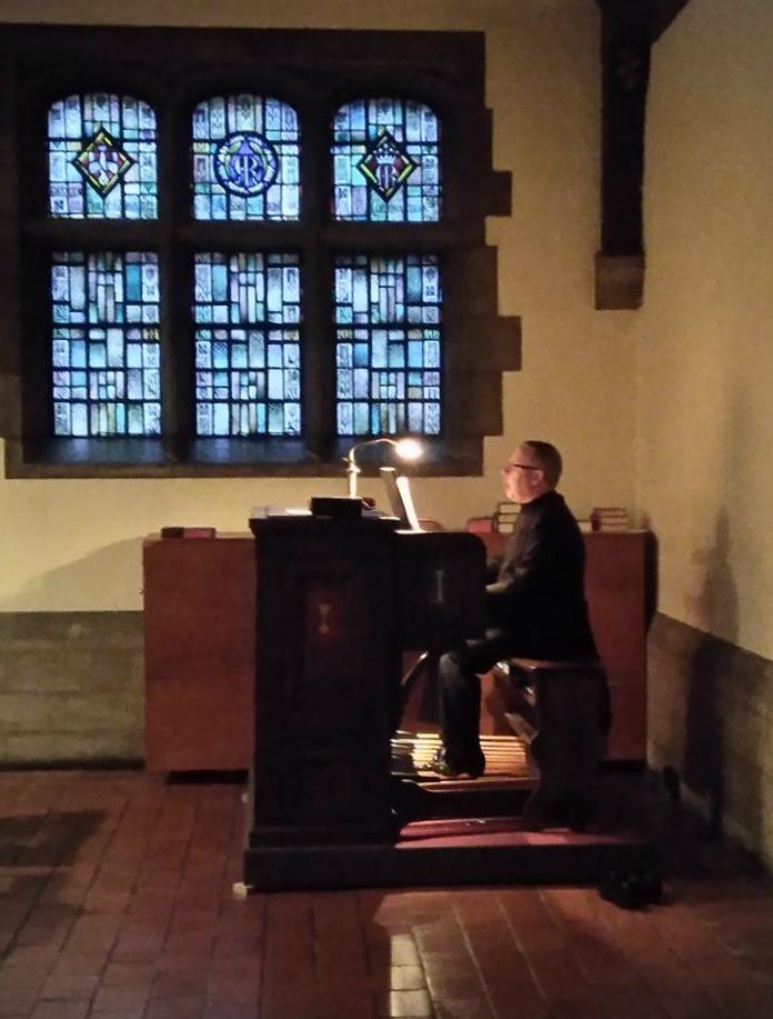 The Rector, Fr. Richard Alton, plays the organ during a Caroling event Winter 2016