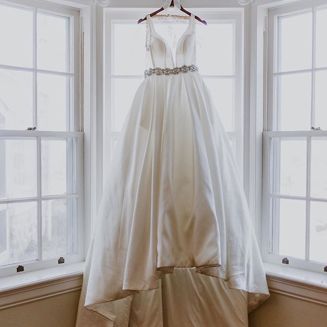 Can you really even have a wedding without the dress in the window photo?