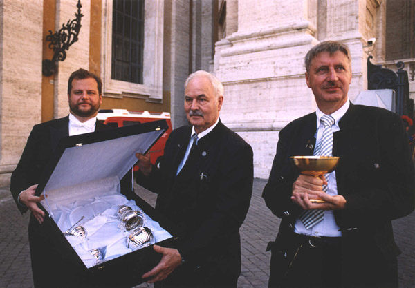 Three members of the Presidium of the Gebetsliga with a silver thurible that was presented as a gift to the Holy Father in gratitude for the Beatification.