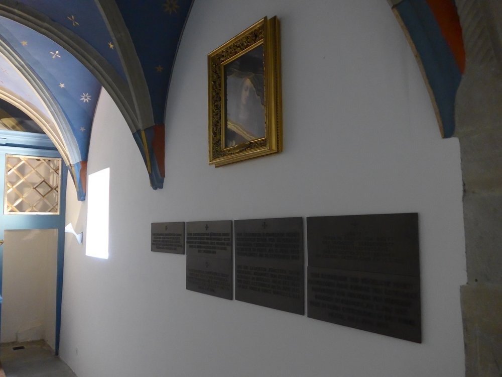 Our Lady of Bowed Head and Plaques
