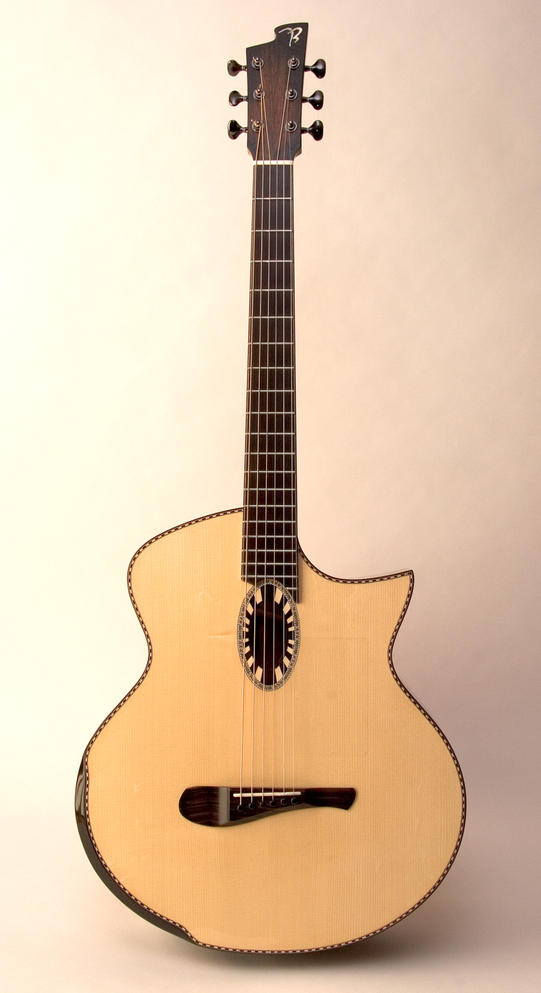 "4G-M with long (27.5"") scale, florentine cutaway, and German Spruce top"