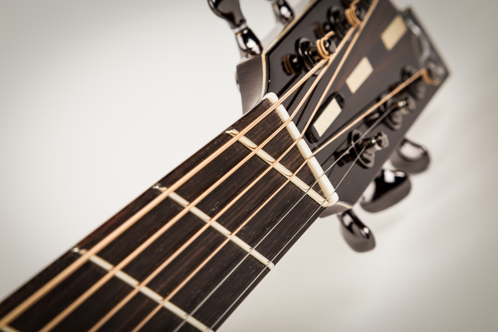 Slant-fret zero-fret and nut spacer