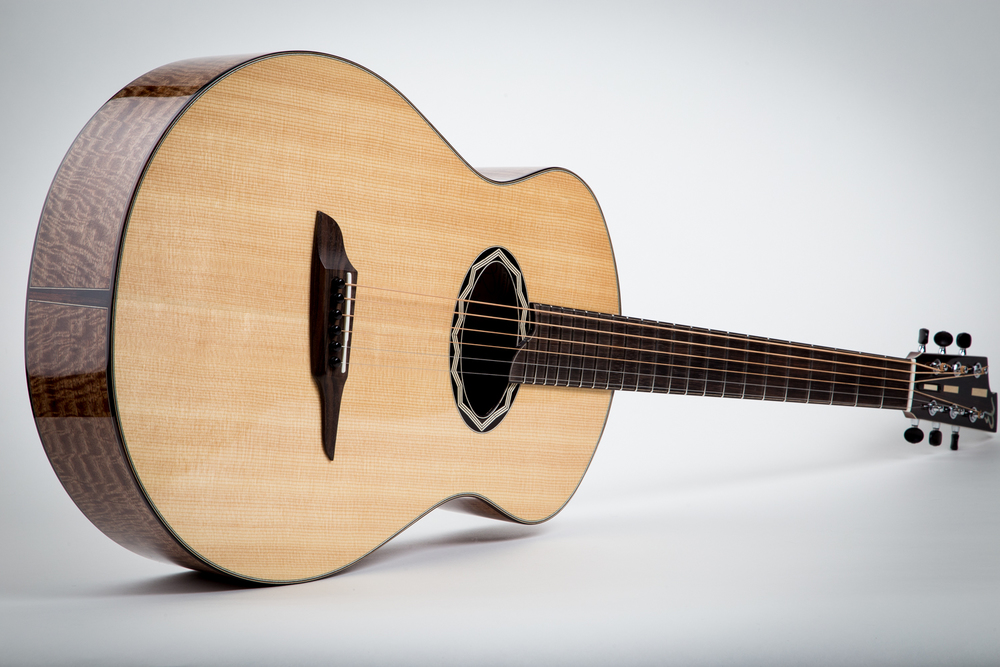 2D-fundamental    curly mango back and sides, lutz spruce top, macassar ebony bridge, fingerboard, appointments