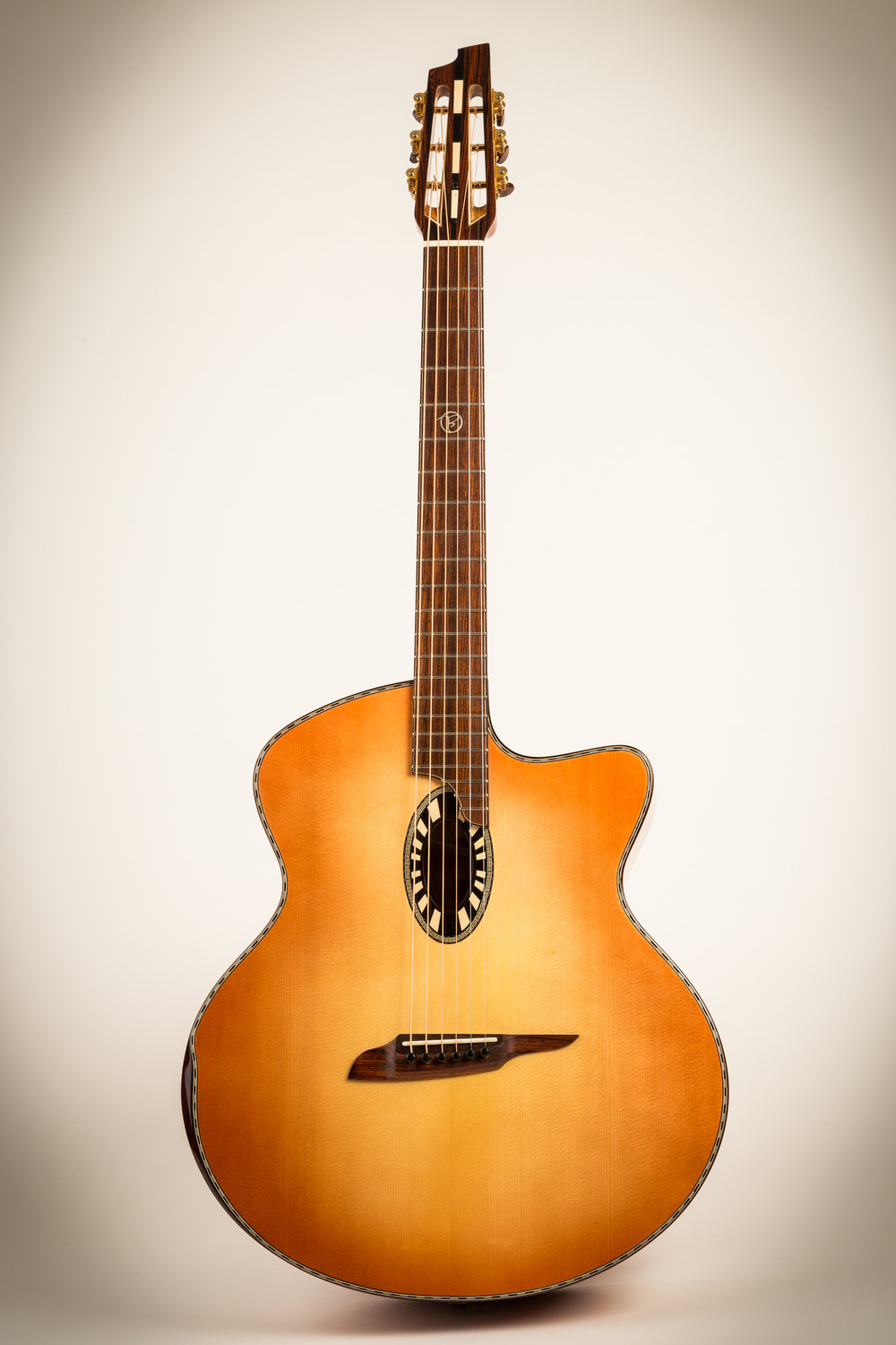 4G-M with sunburst top, slotted headscock, and exceptional curly maple back/sides