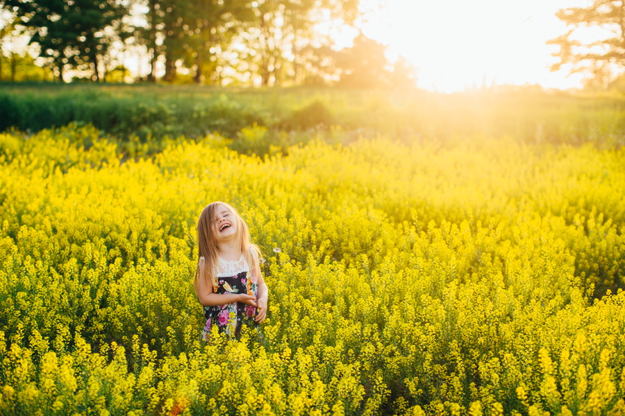 laughing-girl-sunlit-yellow-field.jpg