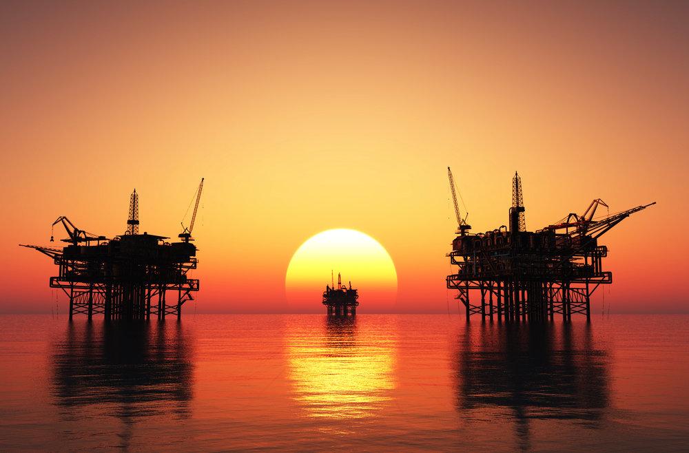 shutterstock_offshore rigs sunset (2).jpg