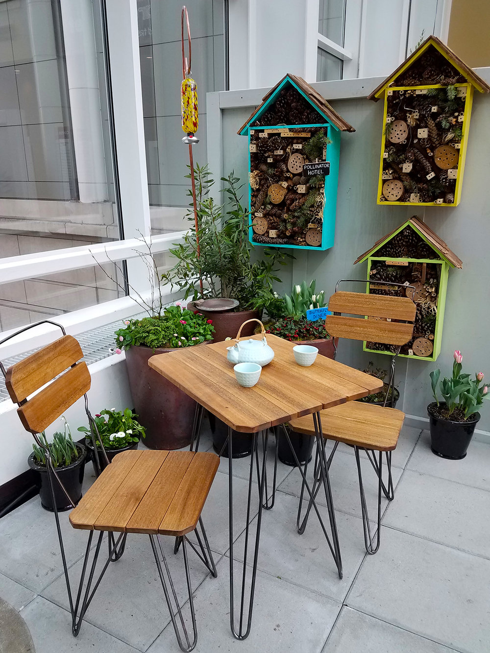 Reclaimed wood bistro set by James Taylor @ Ballard Reuse.  Pollinator Hotels by IslandWood Learning Center.