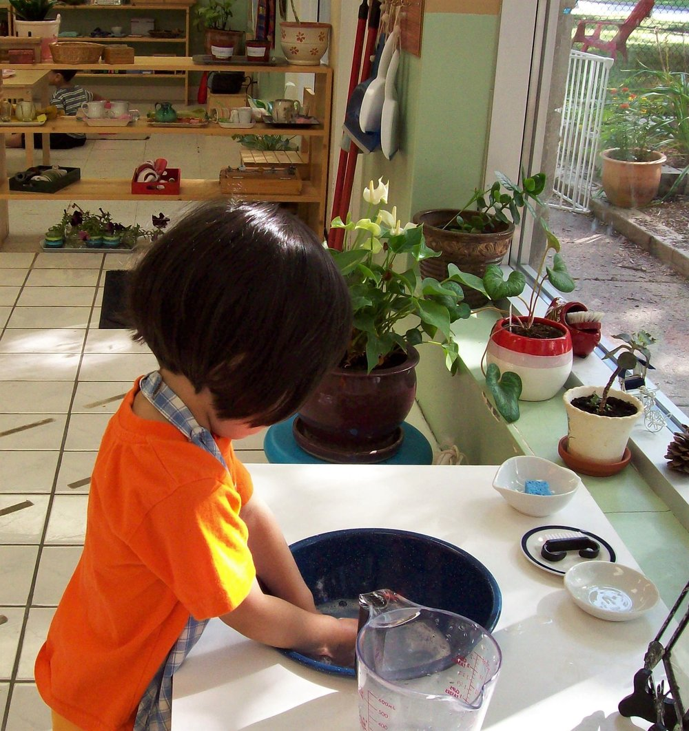 Learning to clean up after themselves at Kaban Montessori in Mississauga