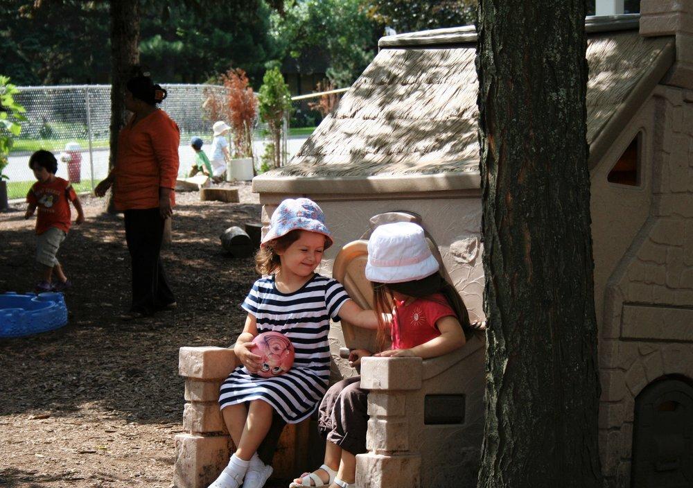 Children talking in school playground at Kaban Montesssori in Mississauga.